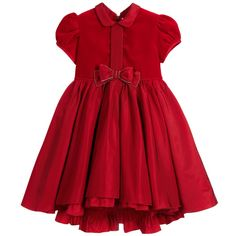 Girls beautiful, rich red dress by Aletta, with a velvet bodice and taffeta skirt. It features pretty puffed sleeves and a taffeta bow at the waist, trimmed with tiny, sparkling diamanté. The taffeta skirt is full and gathered, with a taffeta frill on the lining, which can be seen below the hem. It has a concealed zip fastener at the back with a taffeta sash that ties in a bow.