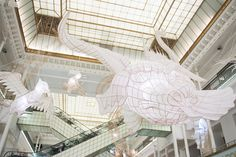 "Ai Weiwei's ""Er Xi"" piece—an installation of bamboo and paper shapes that reference Chinese epic tales and legends. Hung inside Paris's Le Bon Marché."