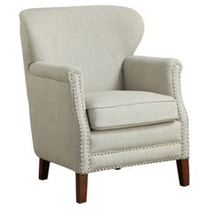 Blending stately style and casual elegance, this chic arm chair brings eye-catching allure to your living room, den, or master suite.