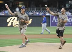 Game #113 8/7/12: Marine Corps Silver Star awardees Master Sgt. David Jarvis, left, and Sgt. Ryan Sotelo throw out the first pitch before a baseball game between the Chicago Cubs and the San Diego Padres at Petco Park on August 7, 2012 in San Diego, California. (Photo by Denis Poroy/Getty Images)
