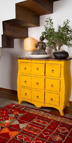 vintage furniture, ethnic rug, bonsai tree