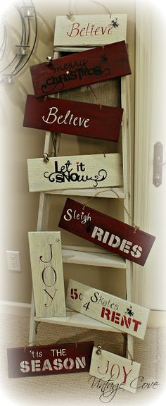 Christmas signs on display on a old ladder, along with other Vintage Christmas decor ideas~by Vintage Cove