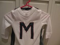 Plain white t-shirt from Old Navy ($3.50)...I sewed a Letter M on the shirt for Max and then added some velcro on the shoulders for a detachable cape!