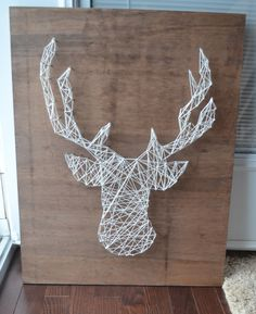 A simple DIY tutorial for making a string art deer head.