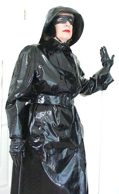 Christine in her shiny black rubber mackintosh