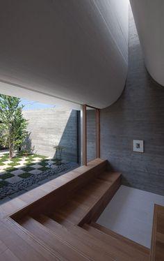 A curving roofline enhances acoustics inside this Japanese house.