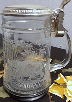 Vintage Made in West Germany Etched Glass and Pewter Wild Boar Ducks Beer Stein Tankard Drinking Cup Lidded West Germany Beer Stein http://www.amazon.com/dp/B0126LAOD8/ref=cm_sw_r_pi_dp_00FRvb147G201