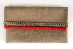 chica clutch bag. A Handmade boho chic fashion clutch bag made of sackcloth, juicy red pon pon , and a unique floral design from the inside!