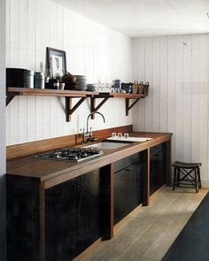 WEBSTA @ wearetriibe - A beautiful rustic kitchen designed by French interior Architect, Christian Liaigre. A clear finished teak counter above black tar stained teak cupboards, - a traditional method used by the De Ru sailors on their boats. It's true what they say, that inspiration is everywhere.