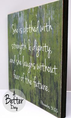12x12 Hanging Sign with Proverbs 31:25 She is clothed with strength and dignity and she laughs without fear of the future.. $35.00, via Etsy.