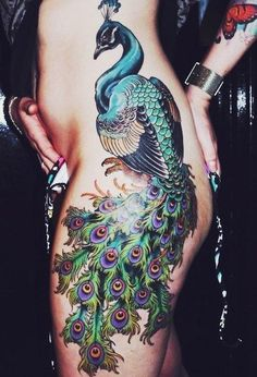 pleasant peacock tattoo on woman side and hip