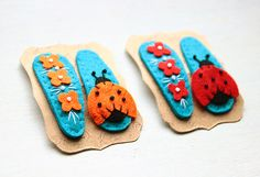 A pair of felt hair clips red flowers and a ladybug by mirgumargu