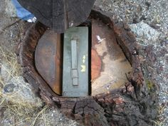 Stump hide ammo can. Great idea for hiding something outdoors!