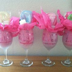 Bachelorette party survival kits in etched wine glasses, cute for the limo. Have all drinks at dinner served in each glass.