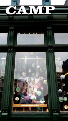 REI SoHo window, featuring strung circular cutouts of our Spring 2017 catalog.  These are very eye-catching and spin with the store's air currents, drawing the eye of the viewer on the street.
