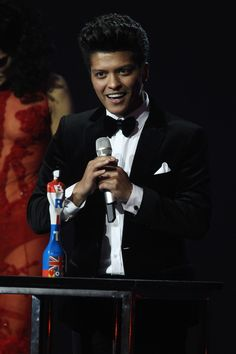 Bruno Mars wears a Dolce & Gabbana suit at The Brit Awards in London