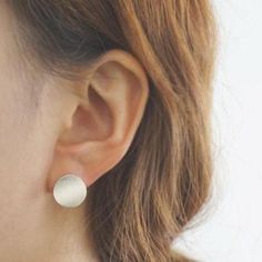 Silver brushed circle earrings