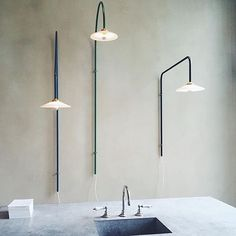 Hanging lamps by #mullervanseveren for valerie_objects at #graanmarkt13 #theapartment #steel #brass #green #blue #black #hanginglights #lamp