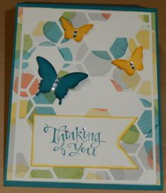 Great butterfly card with Hexagon Hive Thinlits Die over the Watercolor Wonder Designer Series Paper in the background.