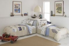 L shaped arrangement. Space-saver for when the crib gets replaced with the twin beds! Better yet, no windows blocked.