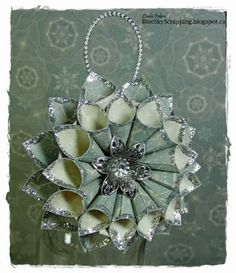 handcrafted Christmas ornament from BlueSkyScrapping .... rolled tubes ..  tutorial on the blog ... luv the elegant look of soft greens with silver ...
