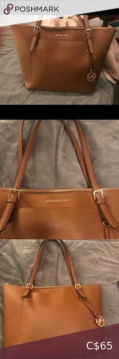 Michael Kors voyager bag- in great condition, the side of one of the handles is slightly ripped off. see pictures. have discounted the bag to reflect that. See Picture, Womens Tote Bags, Michael Kors Bag, Totes, Best Deals, Pictures, Closet, Things To Sell, Travel