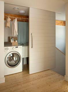 Love this idea, sliding door to hide laundering!