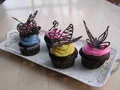 Easy to make chocolate butterfly cupcake toppers.   http://everything-old-crafts.blogspot.com/2011/02/how-to-make-chocolate-butterfly-cake.html