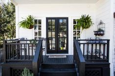 Gorgeous dark doors, side windows, and deck. Chic Home Inspirations with Colonial Design: Stunning Classic Porch Design Pemberton Heights Colonial Exterior Dark Deck, White Deck, White Porch, Up House, House With Porch, Duplex House, House Deck, Deck Colors, House Colors