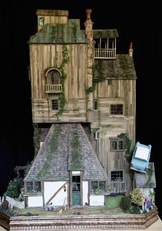 An elaborate and fully decorated dollhouse of the Weasley's Burrow, courtesy of artist Sally Wallace!