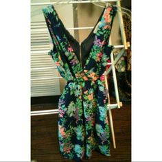 Floral Dress Navy dress with floral design and cut out sides, only worn once Dresses