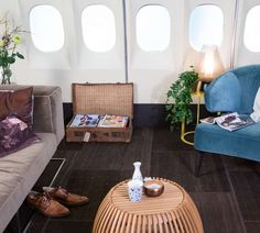 KLM and AirBnB will be inviting guests to sleep over in a fully refurnished airplane that isn't going anywhere. Sleepover, Floor Chair, Aircraft, Table, Blog, Furniture, Reading, Home Decor, Aviation