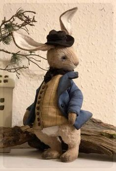 "Peter Rabbit By Tetiana Sadovska - New pattern and new size) Sewn in the style of ""antique"" from viscosefilled with sawdust and metal granulate.jacket and hat made of cotton fabricwooden stand included"