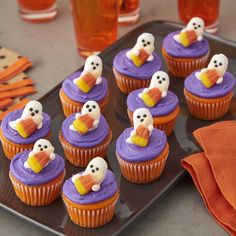 Who doesn't love a two-bite cupcake? These tiny treats are adorable and easy to make using the Wilton Royal Icing Ghost and Candy Corn decorations and the Wilton Mega Mini Muffin Pan. Great for Halloween party ideas, school functions or any time you need mini cupcakes that makes a huge impact for fun!
