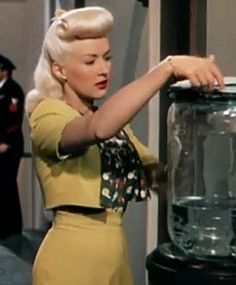 Betty Grable's great 40's style hair...Iove the bangs color photo yellow dress suit skirt top jacket 40s movie star war era pin up girl