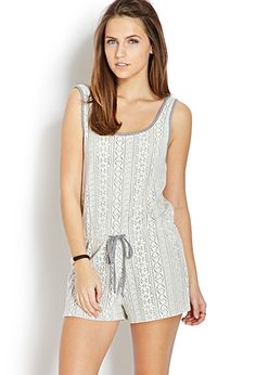 A romper featuring a crochet overlay. Scoop neckline and back.