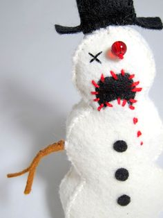 Ways to scare my children off of loving Christmas: #1) Zombie Snowman Ornament