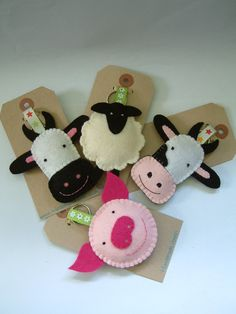 These fun keyrings are made with pure wool felt and stuffed with sheeps wool. Available as a pig, a sheep or a cow (two variations - black or pink nose). Great for party bags/stocking filler/christmas crackers. Felt Crafts, Fabric Crafts, Diy Crafts, Felt Keyring, Keychains, Felt Dogs, Felt Decorations, Christmas Decorations, Creation Couture