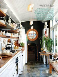 galley kitchen wooden counters cement floor