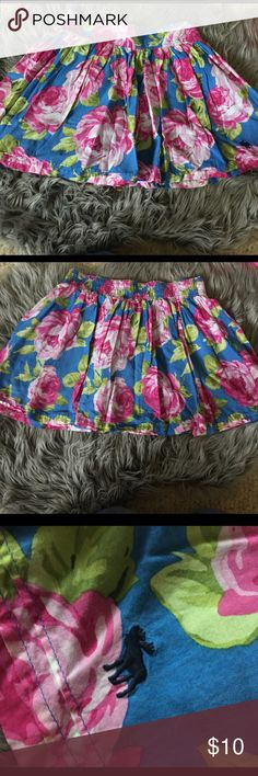 Abercrombie & Fitch Blue and Pink Rose Skirt Super cute skirt size medium. Blue with pink roses. The slip under the skirt is a darker blue. The back of the skirt is cinched and elastic to become larger. Very cute skirt Abercrombie & Fitch Skirts