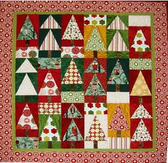 I created Christmas in the Woods after being inspired by the wonderful owl fabric from Robert Kaufman Fabrics. This quilt . Christmas Tree Quilt, Christmas Patchwork, Christmas Quilt Patterns, Noel Christmas, Christmas Fabric, Christmas Projects, Christmas Quilting, Xmas Trees, Christmas Tables
