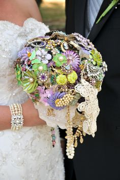 My daughter's wedding bouquet, made by Brooch Bouquets. Crafted out of vintage brooches including special ones donated by the bride and grooms' great-grandmas, grandmas, and mothers. A treasured heirloom.