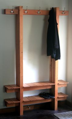 Bench and coat hooks for hubby to take off his dirty work boots and coat in the garage instead of the house entry way :-P