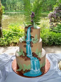Waterfall wedding cake with ferns.