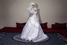 27-years-old Syrian refugee Hatija Ahdiy fled from Syria due to ongoing civil-war poses with her wedding dress at a house in Turkey's Syrian border city Hatay's Reyhanli District on February 08 2016. Hatija had been making marriage plan but canceled due to Assad Regime's attacks. #syria #turkey #türkiye #refugees #refugeecrisis #wedding #marriage #assad #civilwar #home #war #reyhanlı #reyhanli #borders #bride #فرح #عروسه #سوريا #تركيا #gelin #suriyeli #suriye #multeci #middleeast…