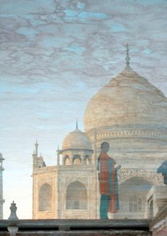 "27. ""Reflection of the Taj Mahal."" Reflection of a woman and the Taj Mahal. Agra, India. (Degrey Phillips / National Geographic Traveler Pho..."