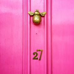 Bee door knocker in margate. Pretty pink front door! Love colourful homes like this