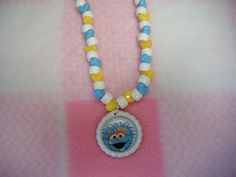 Rosita from Sesame Street Inspired Bottle Cap Necklace by curlyscreations2 on Etsy