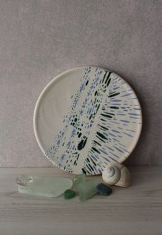Check out this item in my Etsy shop https://www.etsy.com/listing/519499887/hand-painted-tile-ceramic-plate-white