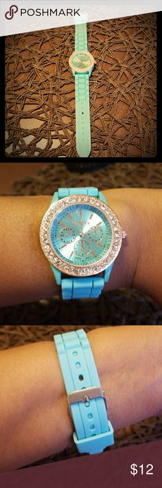 Fancy Turquoise Geneva Watch w/Gold Crystals Bezel Super Cute and fancy Turqouise watch. Has nice turquoise face to match with gold hands. Bezel is gold with crystal like stones. Very nice! I love this watch. Geneva Accessories Watches